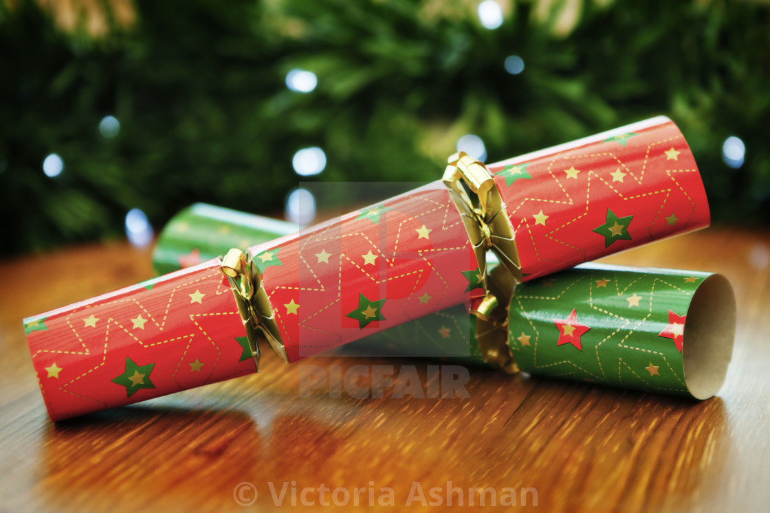 """Christmas crackers, with garland and fairy lights background"" stock image"