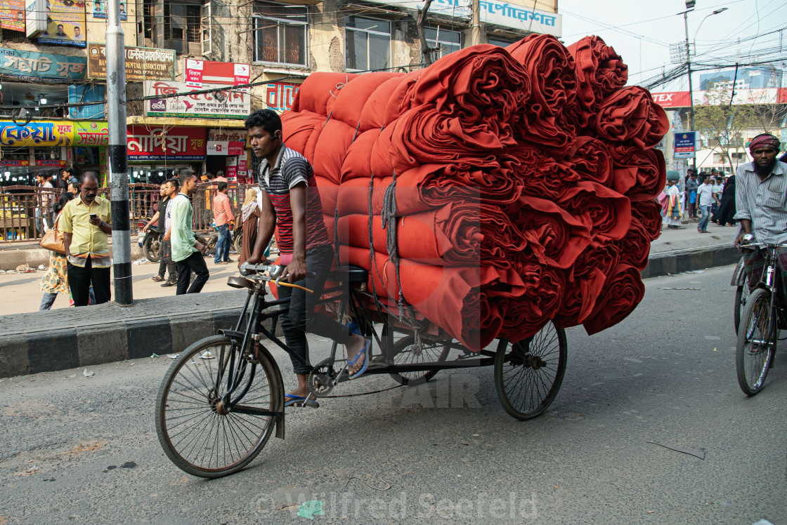 """RED ROLLS OF FABRIC"" stock image"