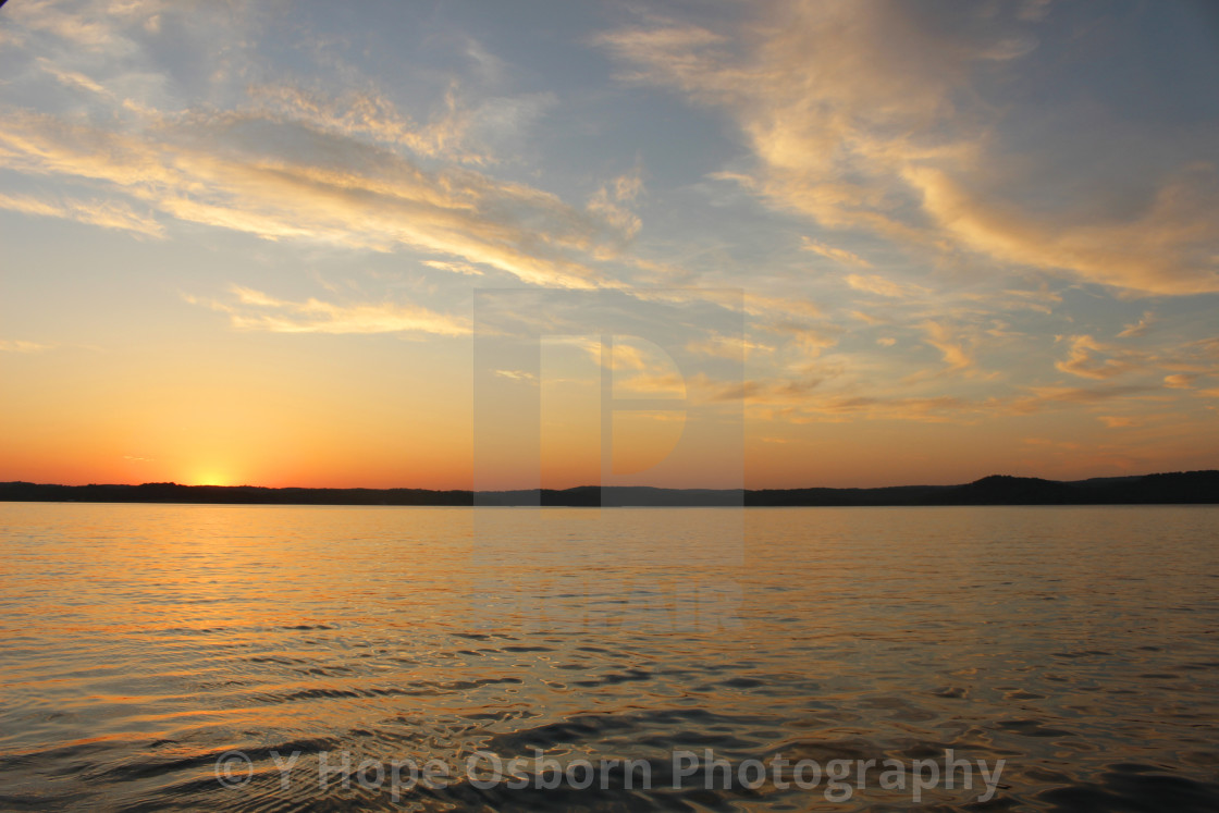 """""""orange and blue sky sunset over water"""" stock image"""
