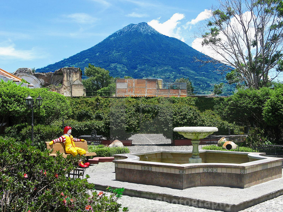 """old volcano in background of courtyard"" stock image"