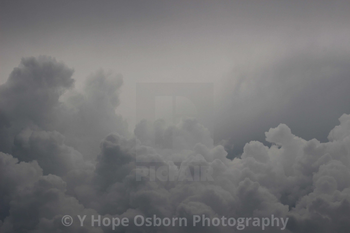 """variegated grey towering storm clouds"" stock image"