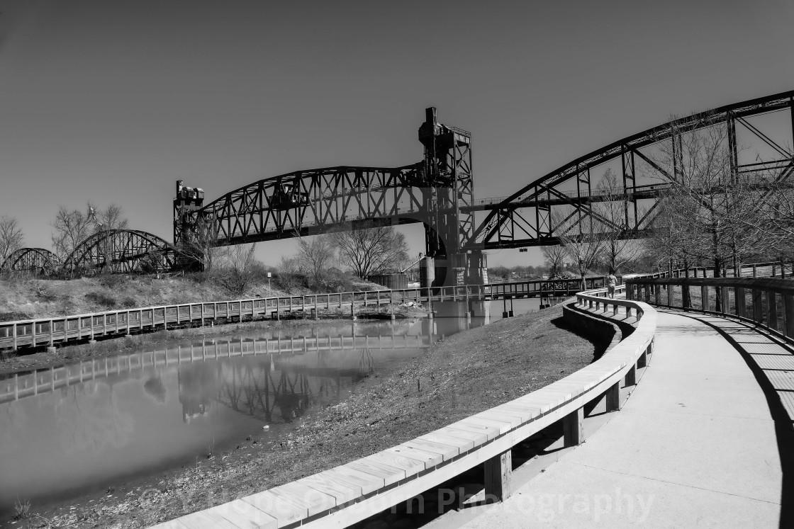 """Pedestrian Clinton Presidential Library bridge in black and white"" stock image"