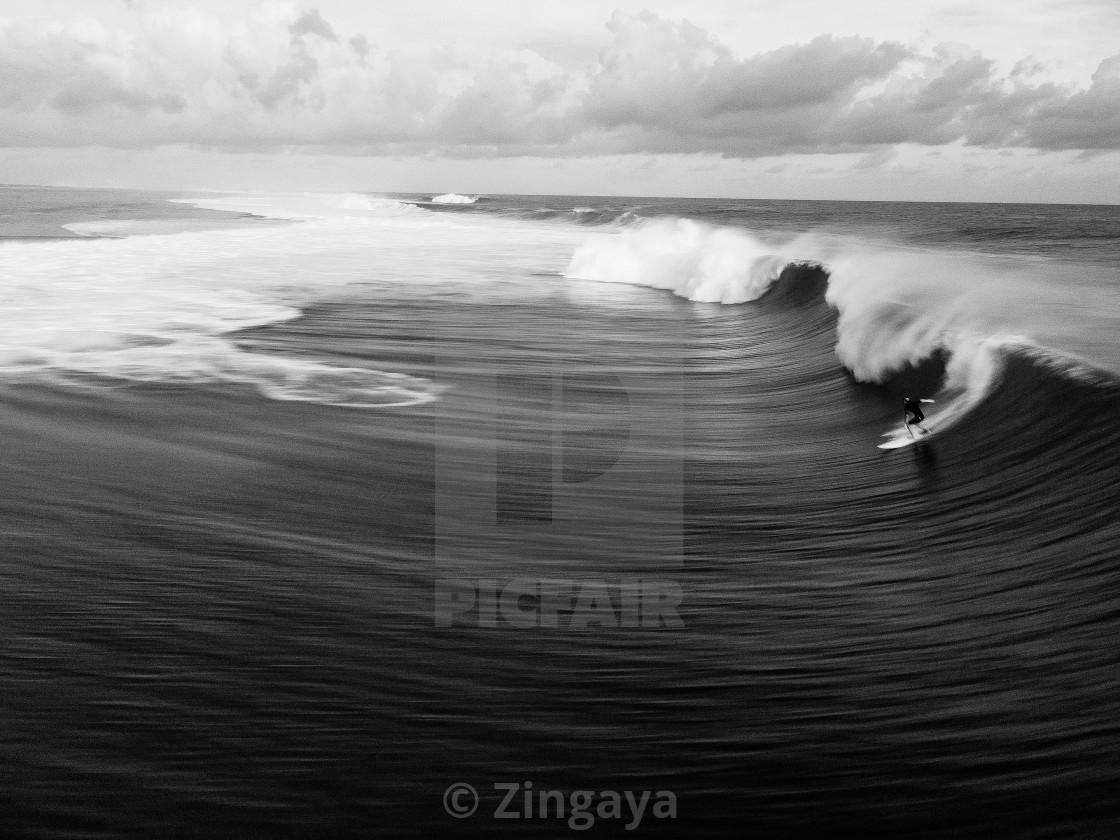 """Surfer dompting teahupoo"" stock image"