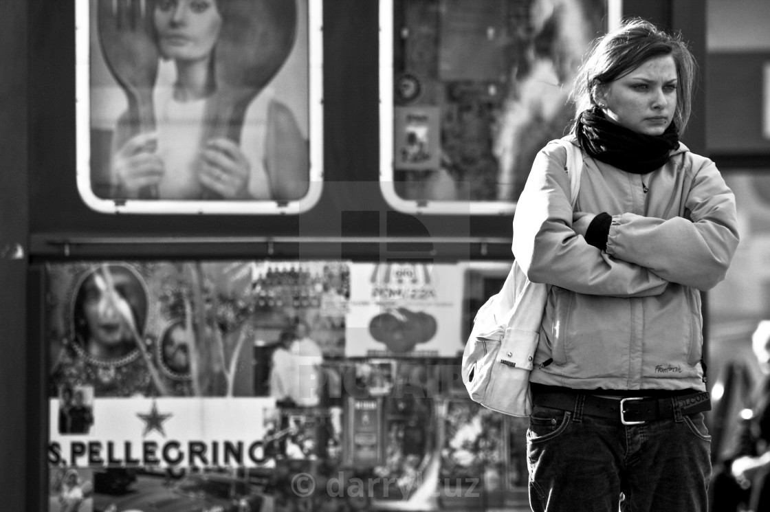 """""""Young girl waiting impatiently in front of Churchill Square shopping center in Brighton, UK."""" stock image"""