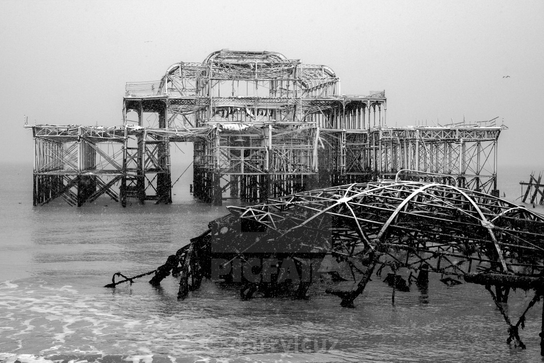 """""""Winter scene of the ruin of the collapsed West Pier covered in snow in Brighton, UK."""" stock image"""