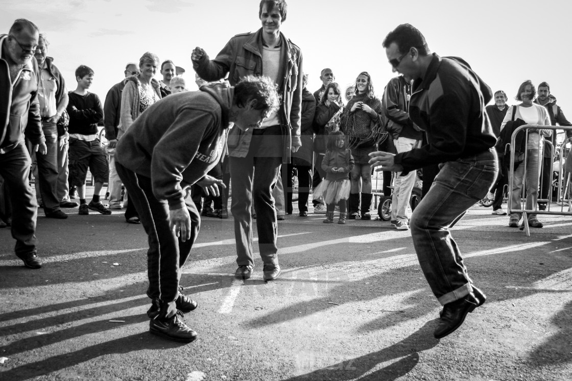 """A dancer shows a homeless man how to Jive at a festival in Brighton, UK."" stock image"