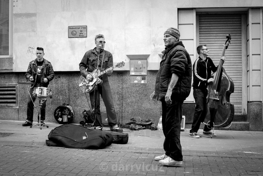 """""""A homeless man joins a rockabilly band on the street in Brighton, UK."""" stock image"""