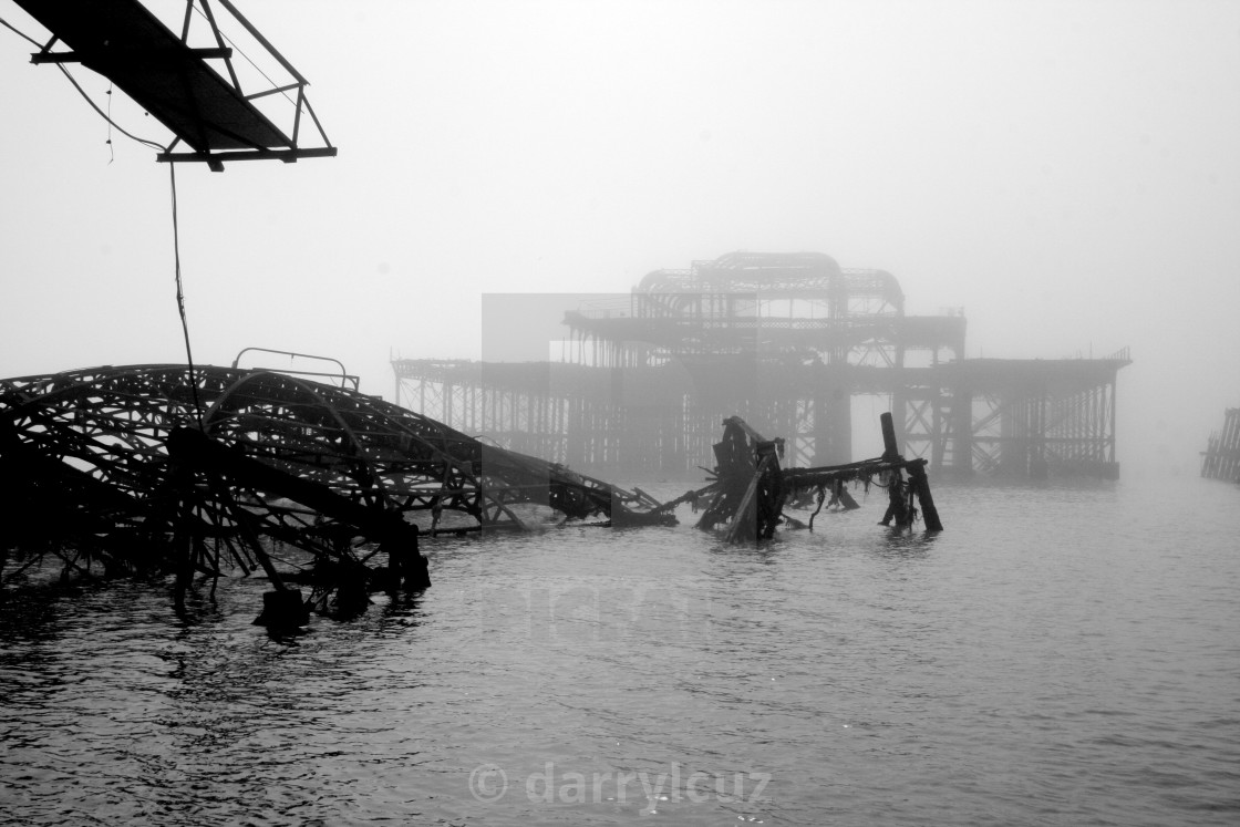 """""""View of the collapsed Concert Hall of the Victorian West Pier on a misty day in Brighton, UK."""" stock image"""