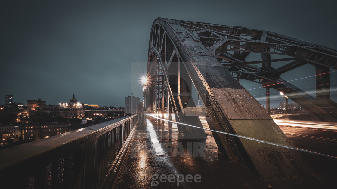 """Going home across the Tyne Bridge, Newcastle at dusk."" stock image"