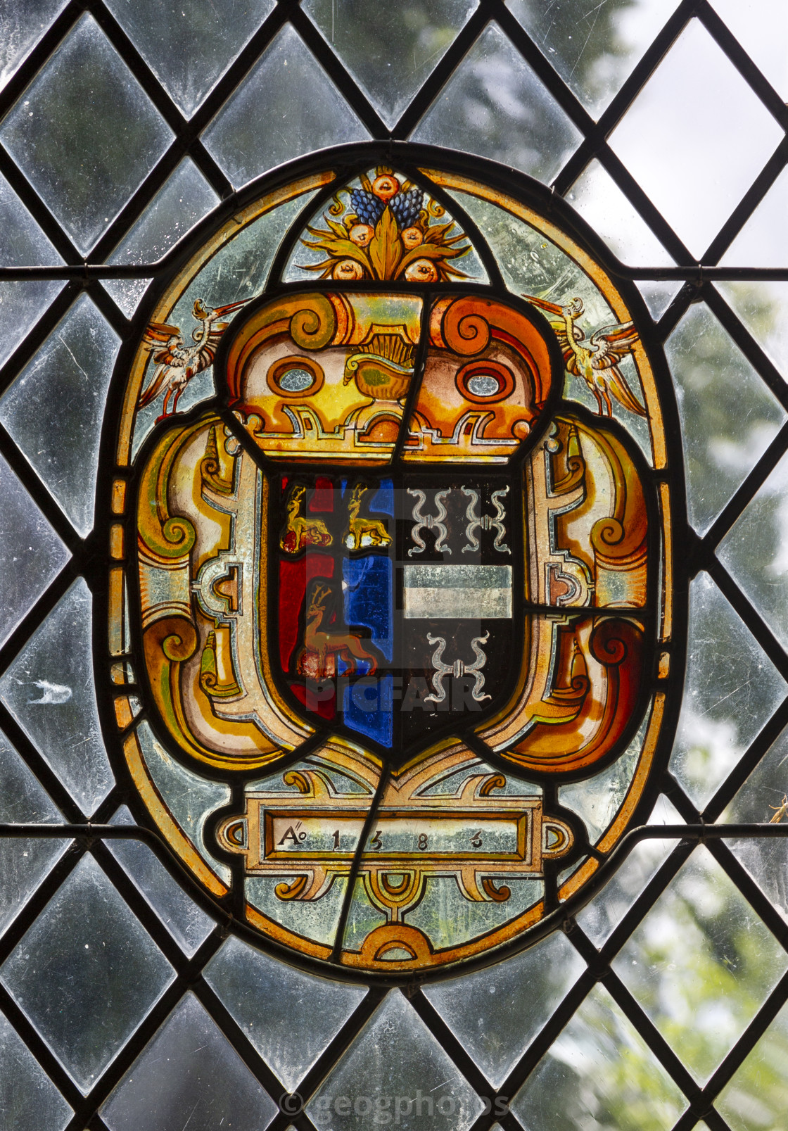 """""""Stained glass roundel in medieval heraldic style dated 1583, detail of..."""" stock image"""
