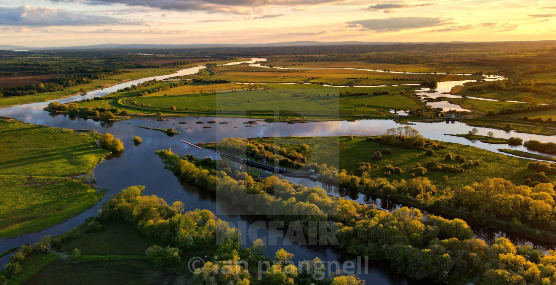 """""""Sunsets over Meelick Weir in Co Tipperary"""" stock image"""