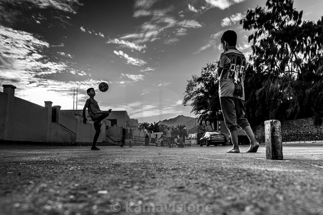 """""""Kids playing near Muscat, Oman"""" stock image"""