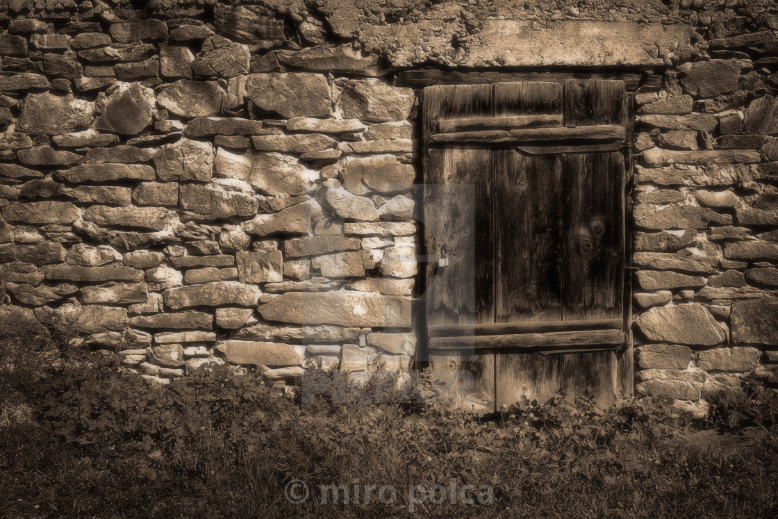 """stone wall and wooden door"" stock image"