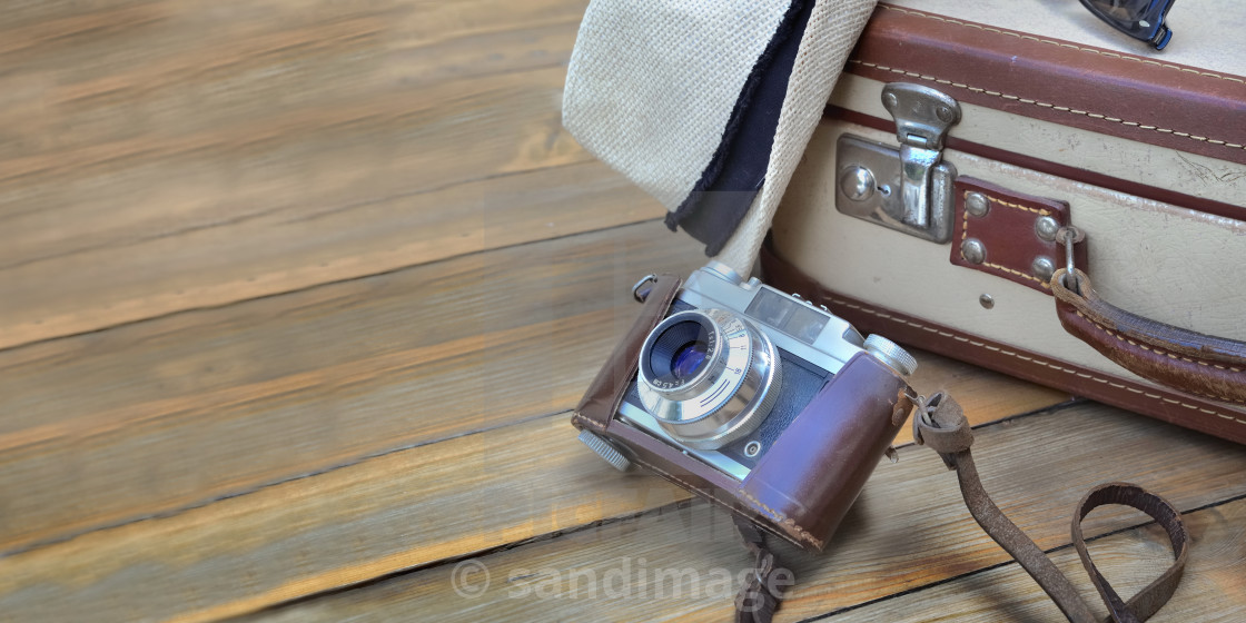 """retro suitcase and camera on wooden background with hat"" stock image"