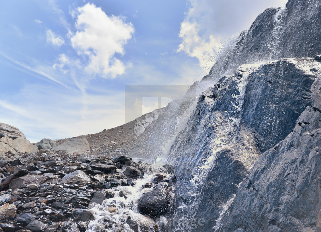 """""""close on water flowing from glacier on a rocky wall in alpine mountain"""" stock image"""