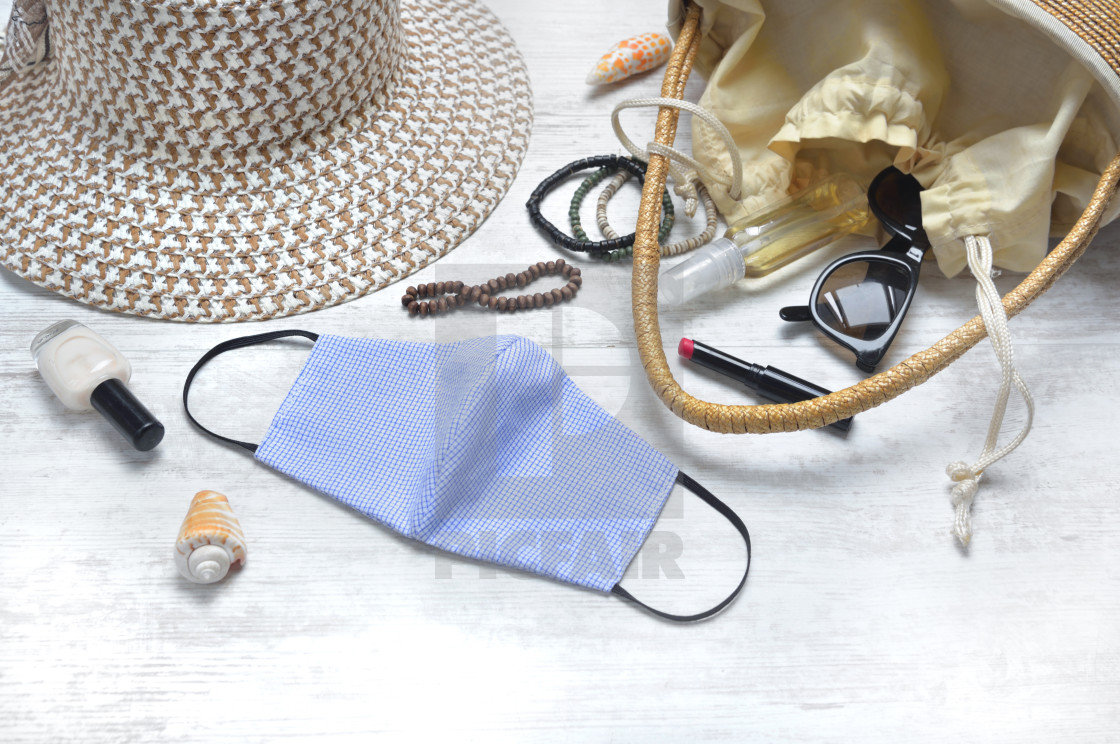 """fabric handmade mask on a table with handbad and beauty accessor"" stock image"