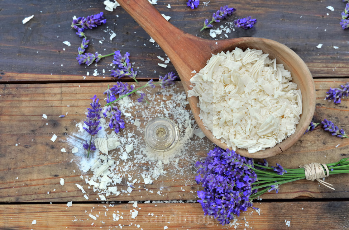 """spoon full of flakes of soap with essential oil and bunch of lavender flowers"" stock image"
