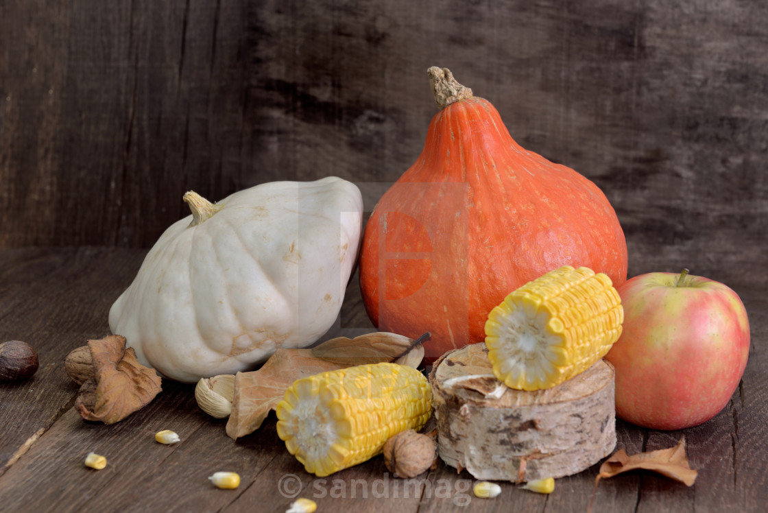 """""""various and colorful autumnal vegetables and fruits on wooden background"""" stock image"""