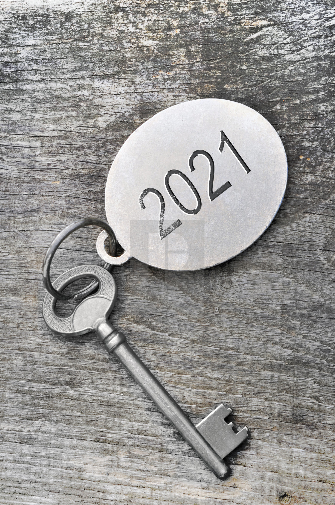 """2021 engraved on a ring of an old key on white background"" stock image"