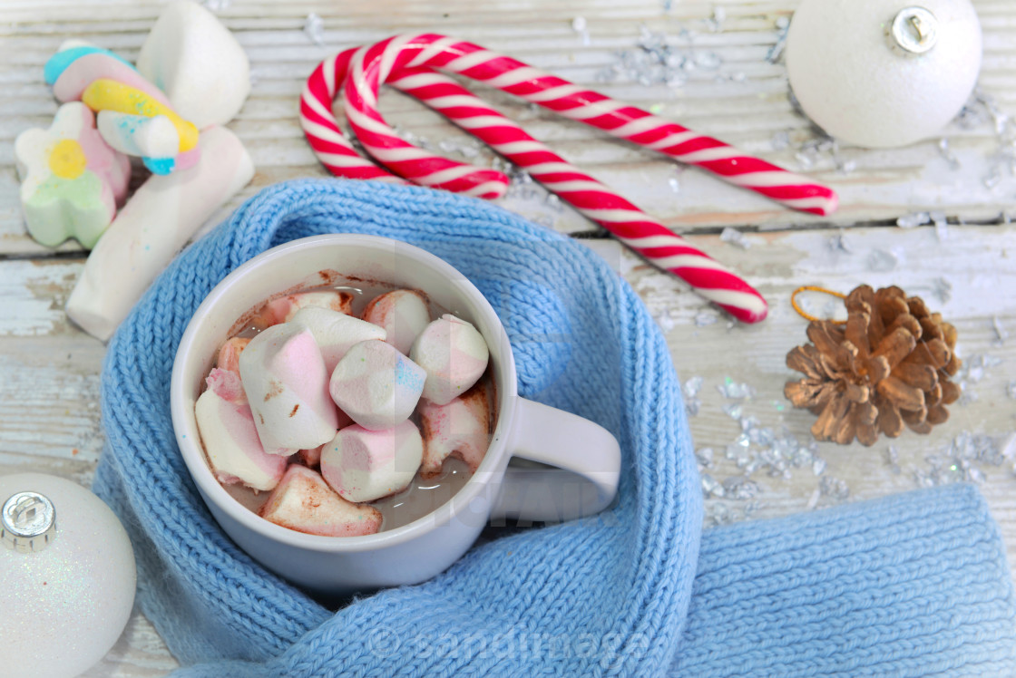 """""""mug of marshmallow in milk chocolate surrounded by blue scarf on"""" stock image"""