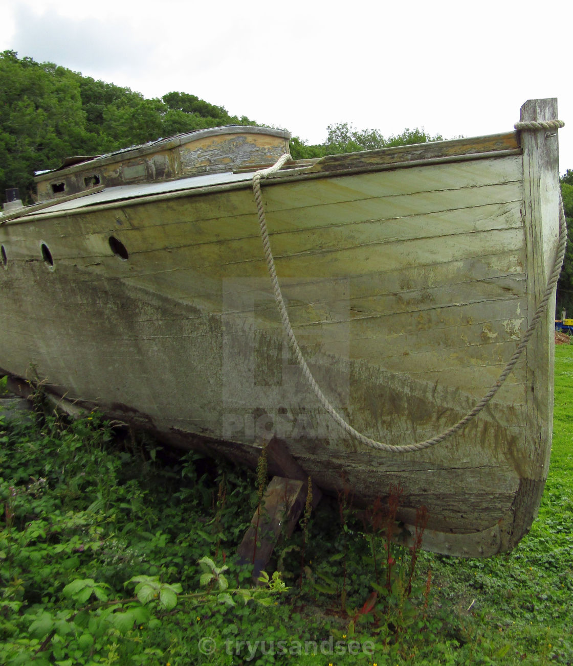 """Derelict wooden boat in field"" stock image"
