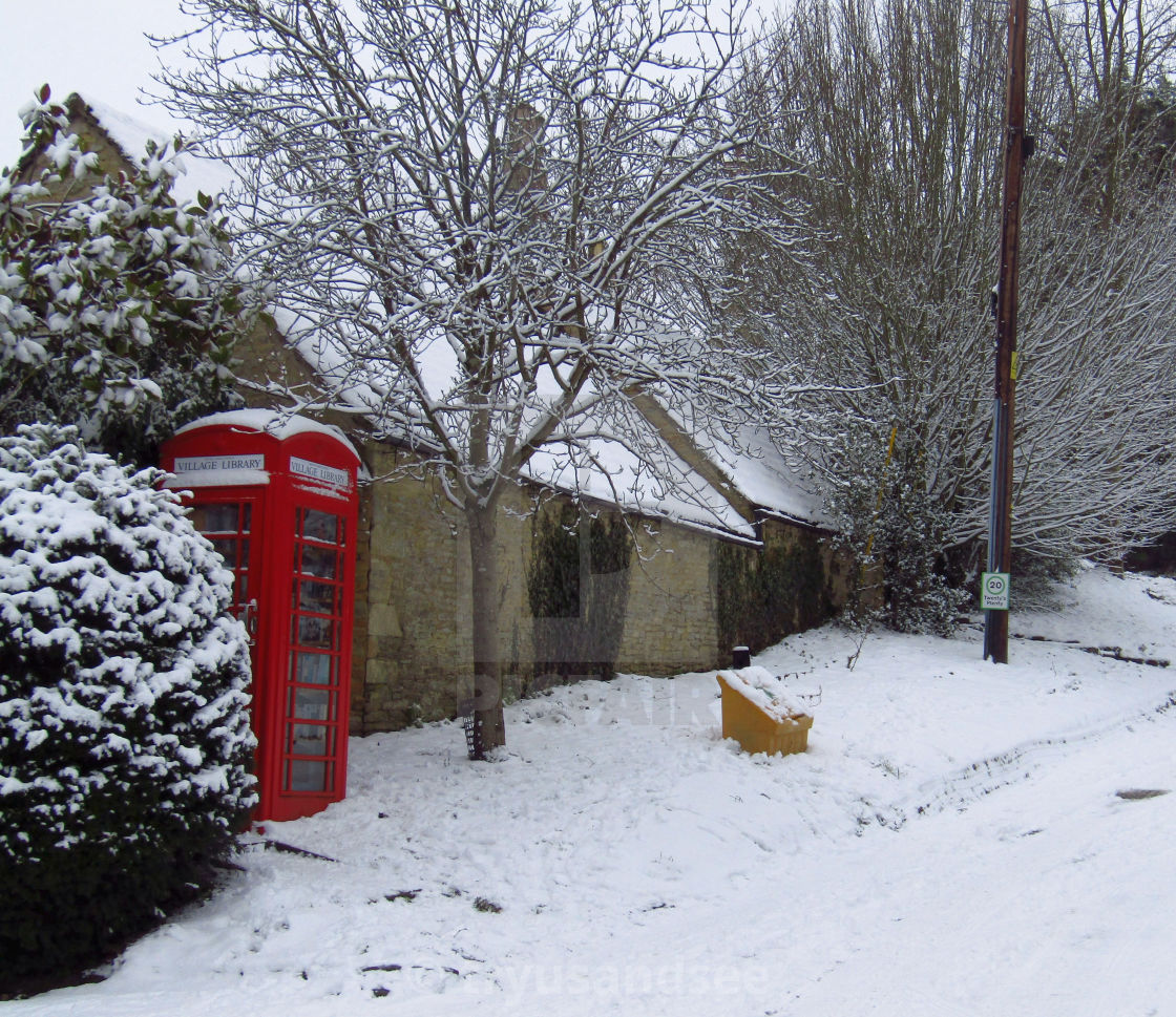 """""""Cotswold village library in winter snow"""" stock image"""