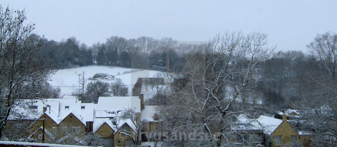 """""""Cotswold village in Winter snow"""" stock image"""