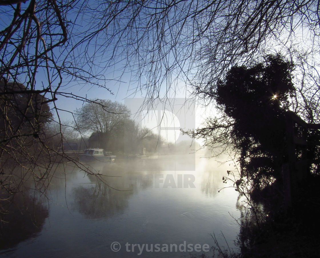 """""""Tranquil misty morning on the Oxfordshire Thames"""" stock image"""