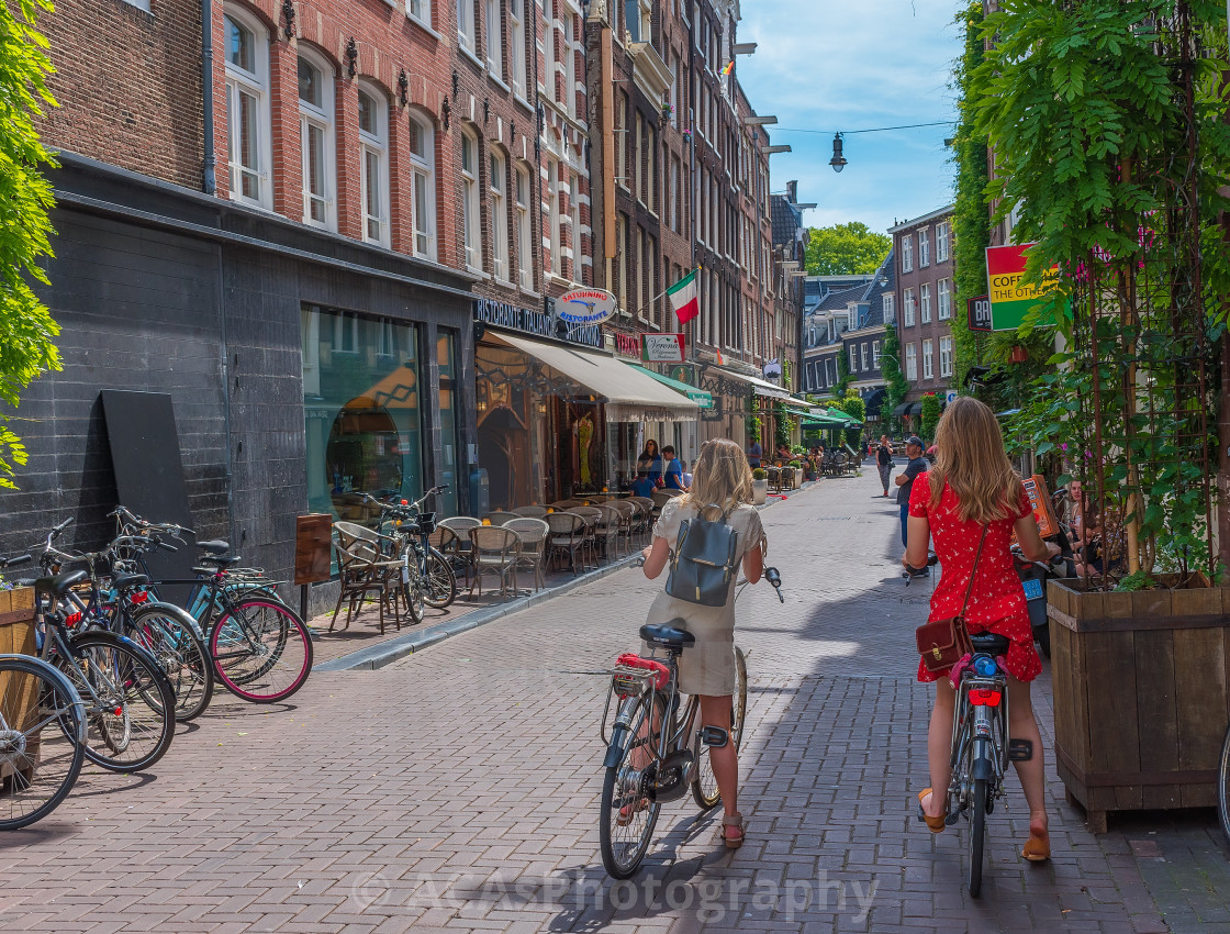 """Cycling in Amsterdam."" stock image"