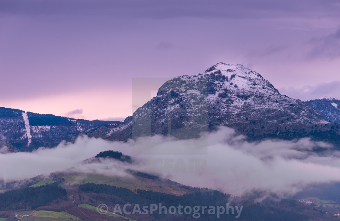"""Purple sunset in Untzillaitz mountain"" stock image"