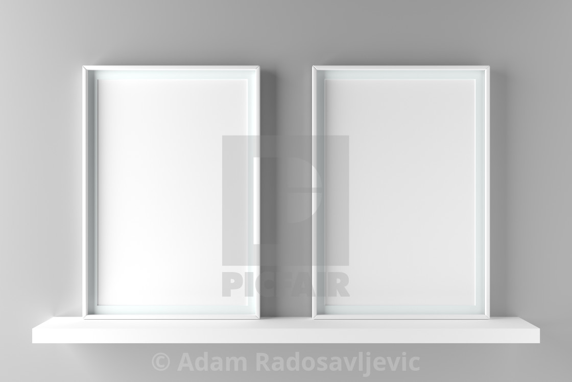 Two elegant frames stand on the shelf  3D render - License