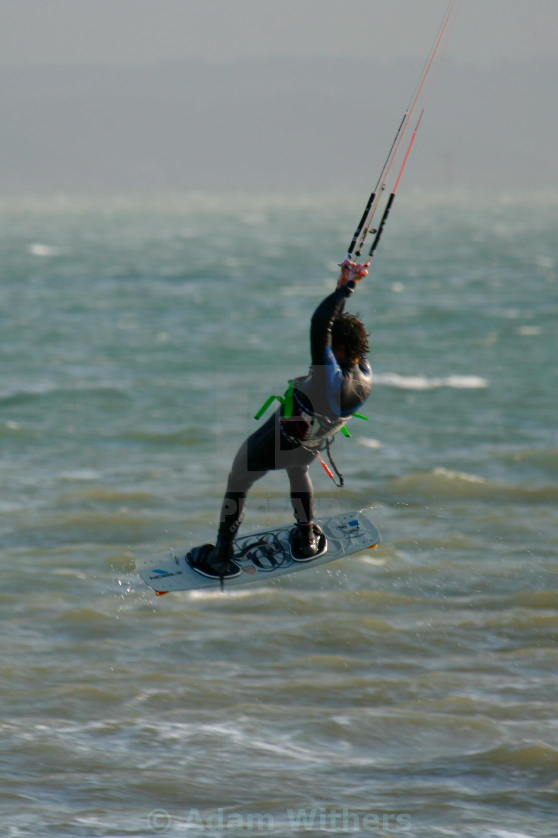 """Kitesurfing Dude getting Air"" stock image"