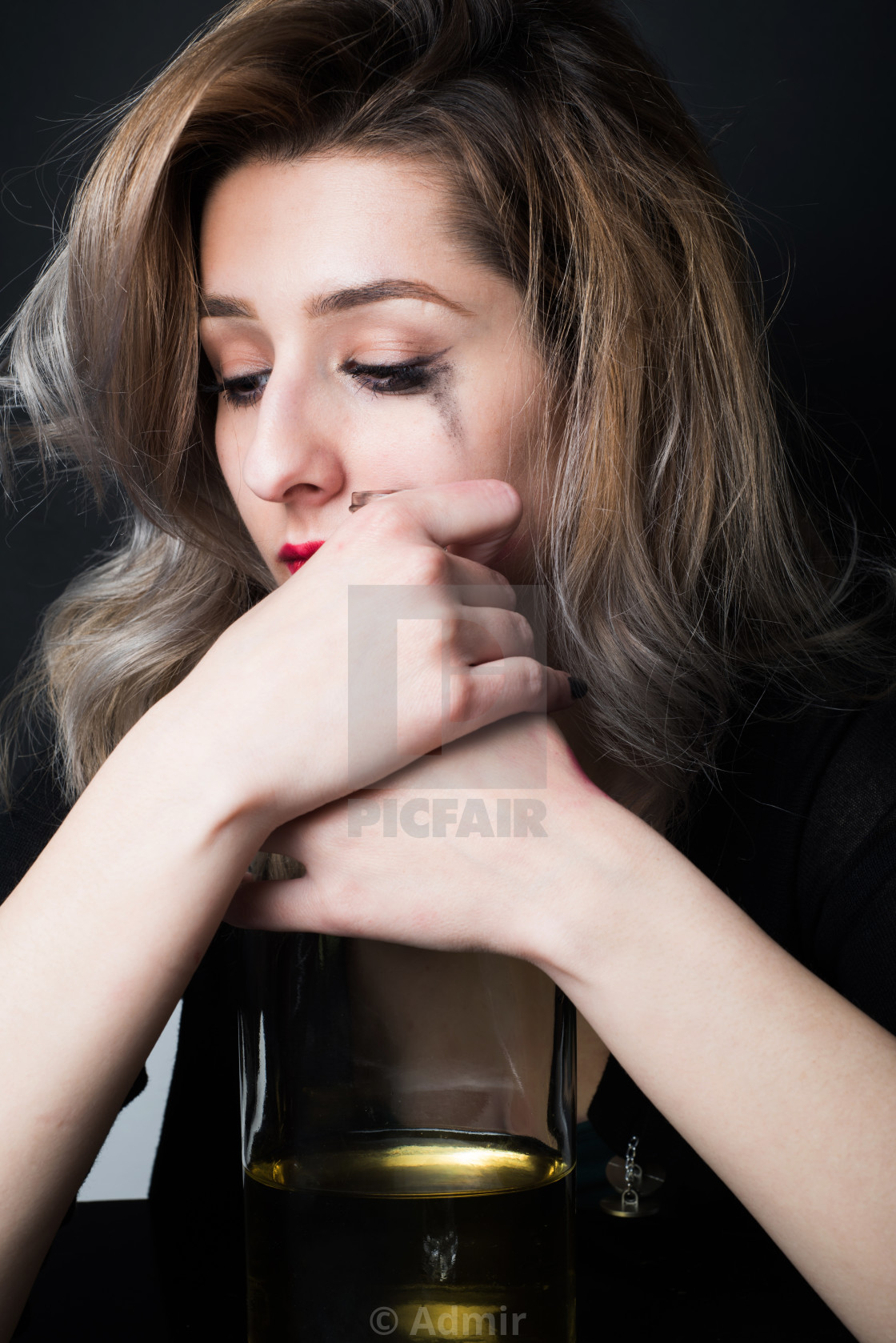 """young desperet woman with bottle of alcohol in hands"" stock image"