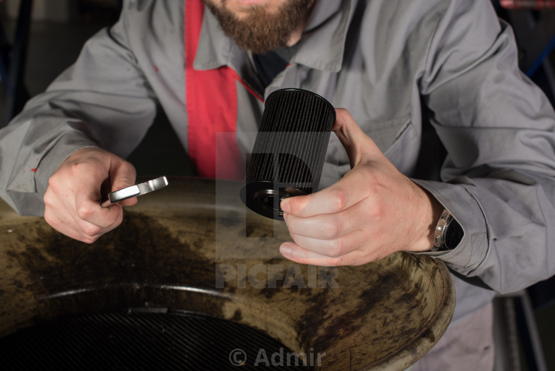 """hands with oil filter and wrench"" stock image"
