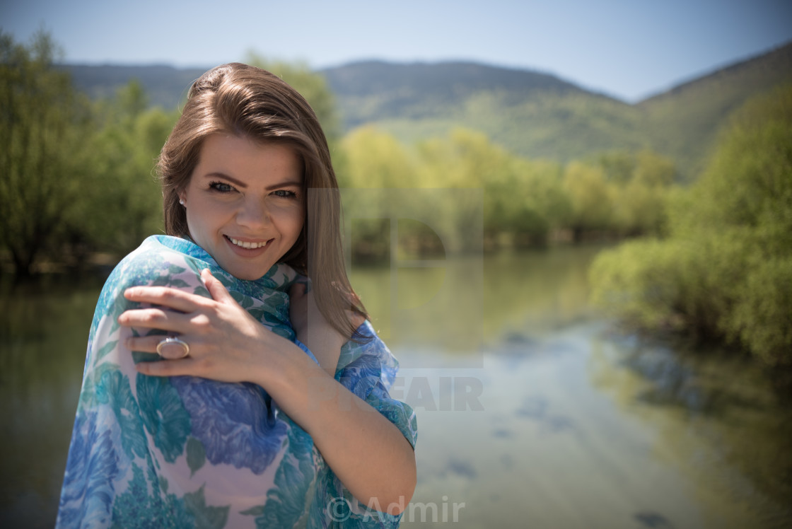 """woman smiling in nature portrait"" stock image"