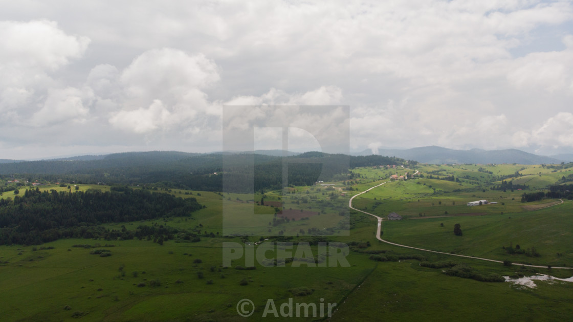"""fields and river by the road from air"" stock image"