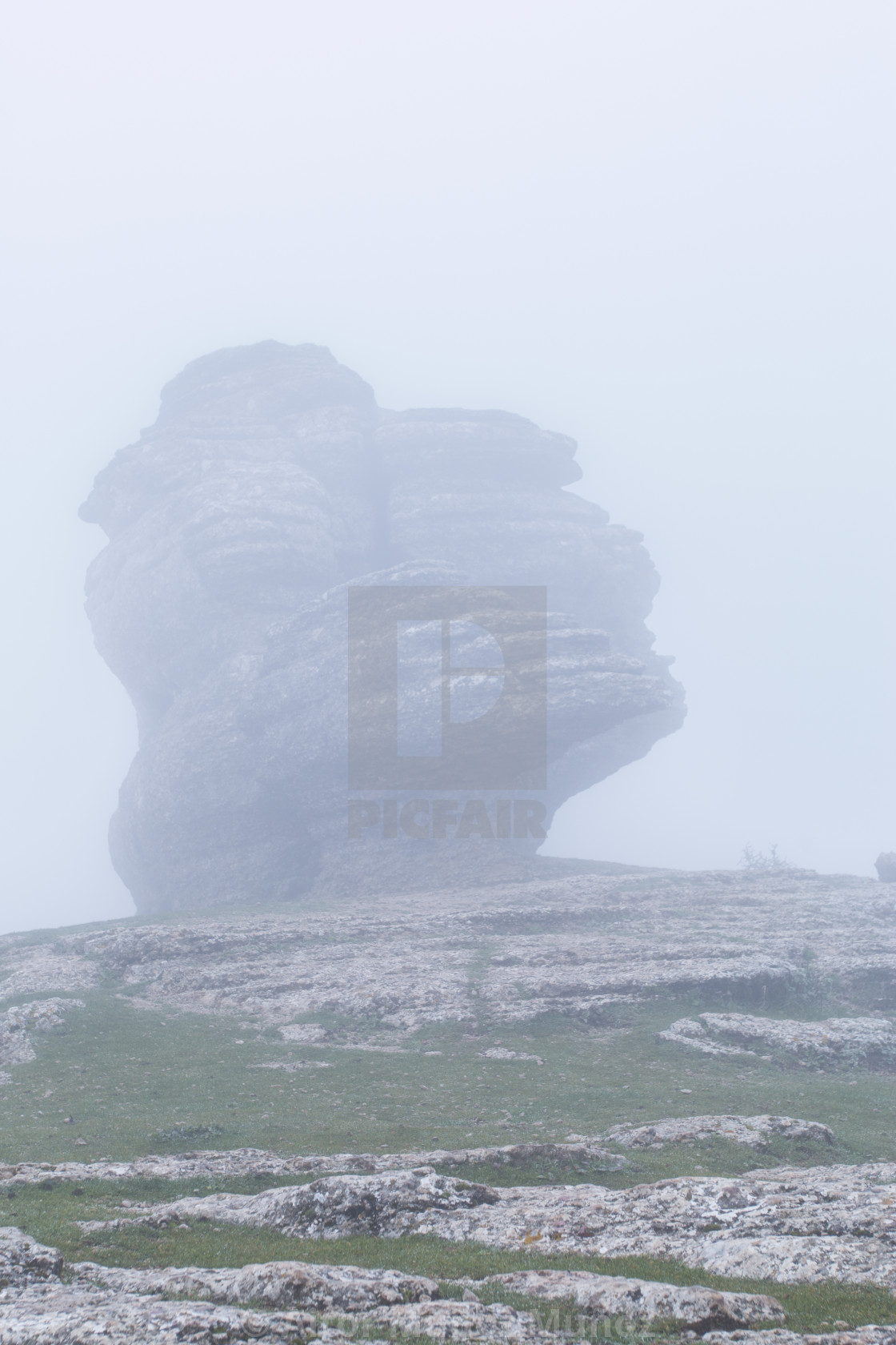 """""""Gigantic rocks lying on hill slope in fog. Torcal in Antequera,"""" stock image"""