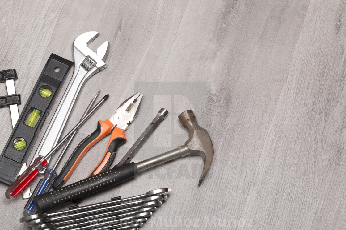 """Hammer and wrenches on desk"" stock image"