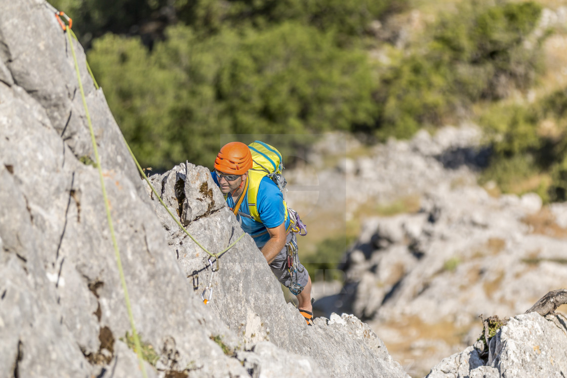 """Explorer climbing on mountain"" stock image"
