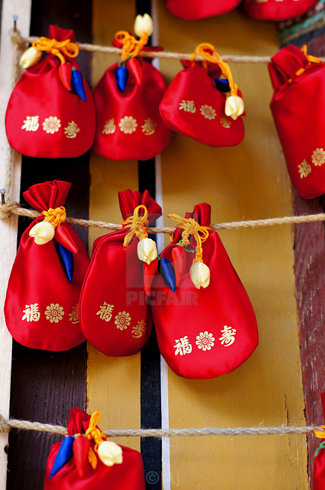 """Red pouch charm at the temple"" stock image"