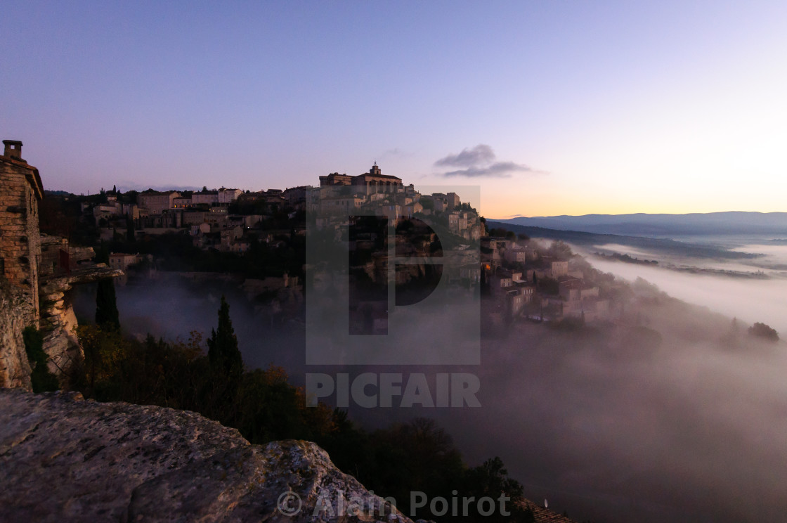 """Hill village rising out of the clouds"" stock image"