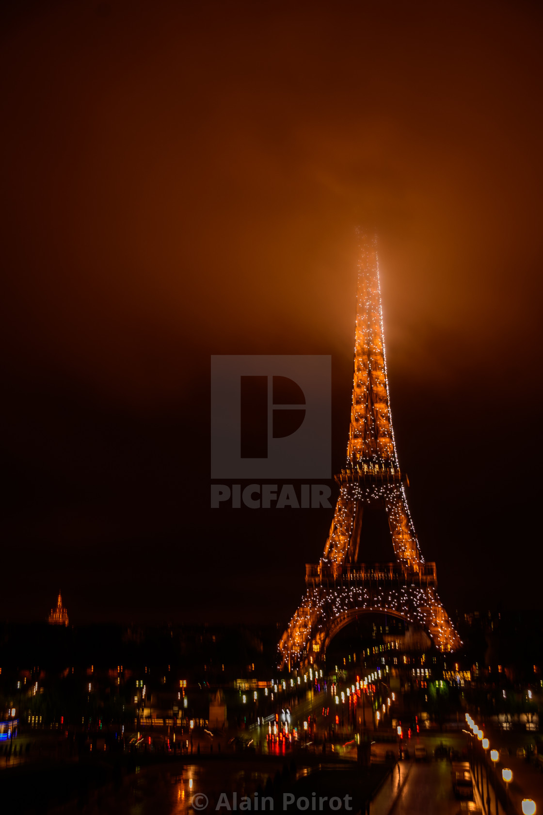 """""""Eiffel Tower at night / summit in the clouds"""" stock image"""