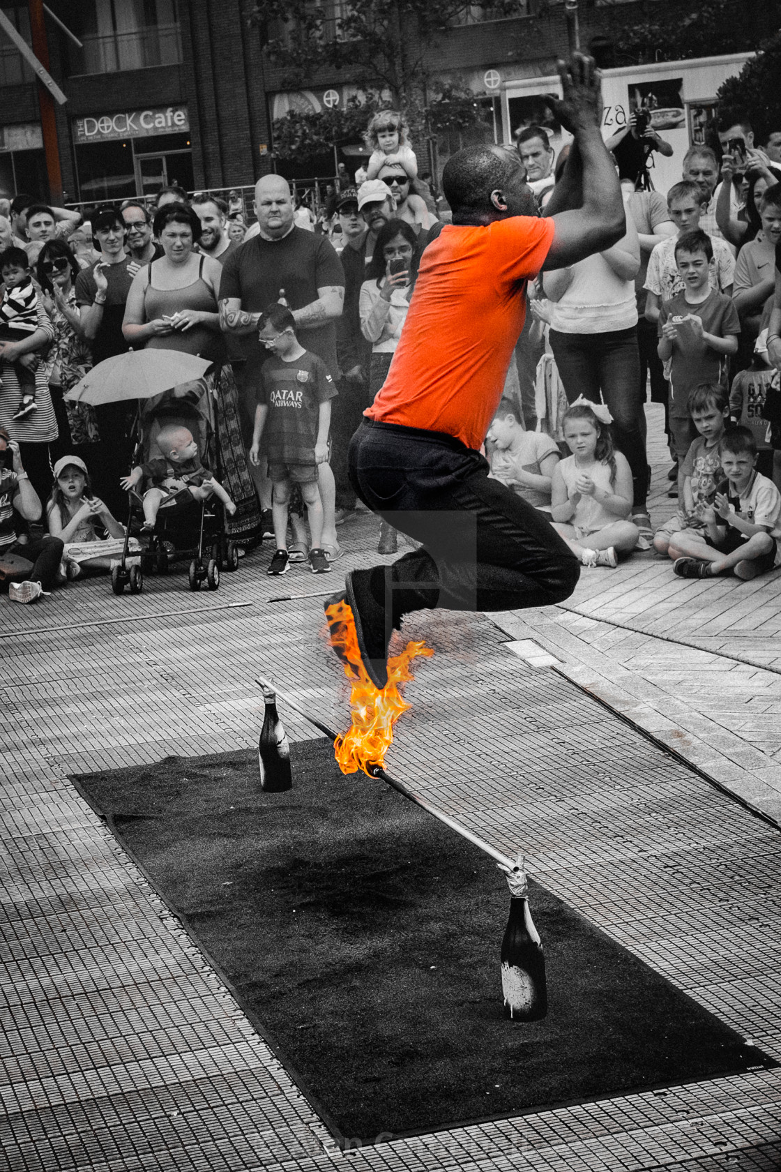 """Jumping over the flame"" stock image"