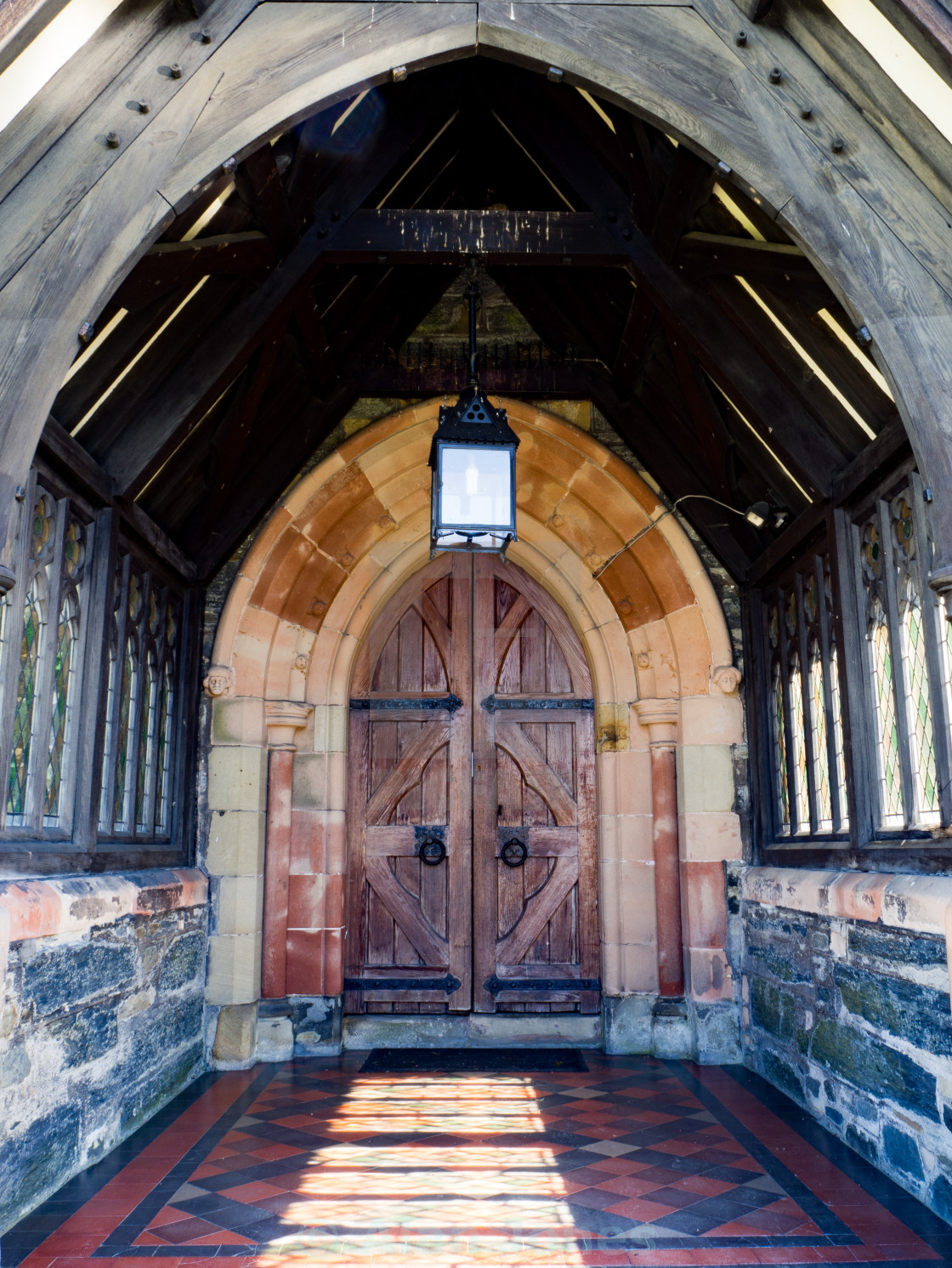 """St. Trillo's Church doorway"" stock image"