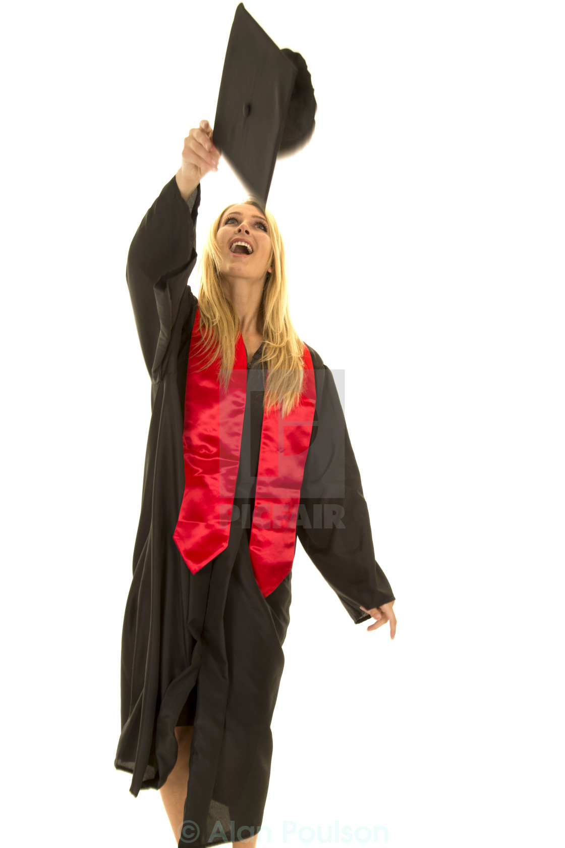 woman in black graduation gown throwing cap - License for £14.88 on ...