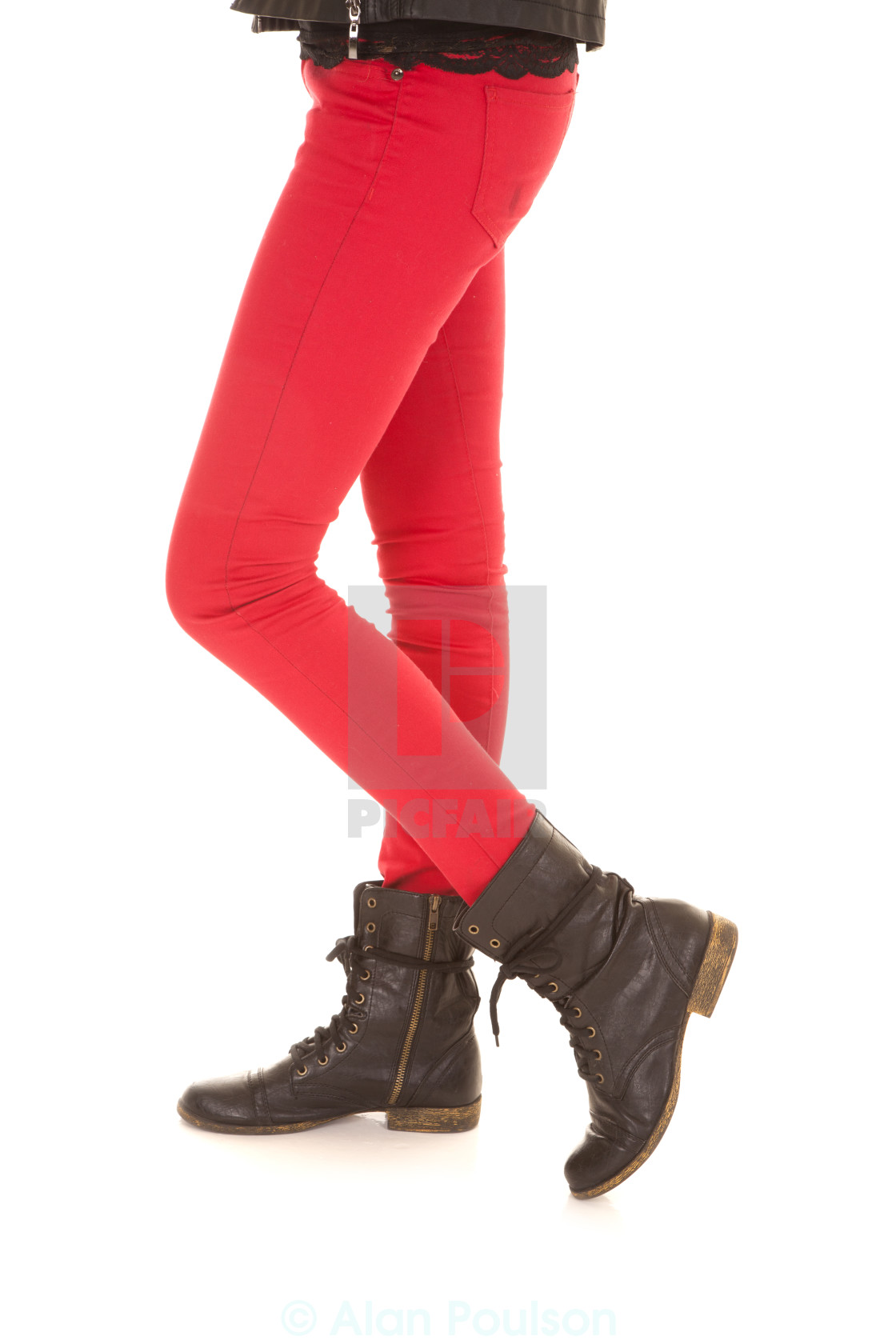 """red pants woman legs boots one on toe"" stock image"