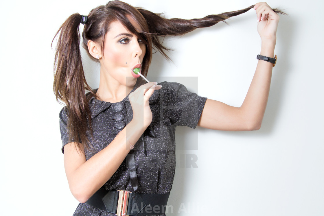 """""""cute girl with a lollipop"""" stock image"""