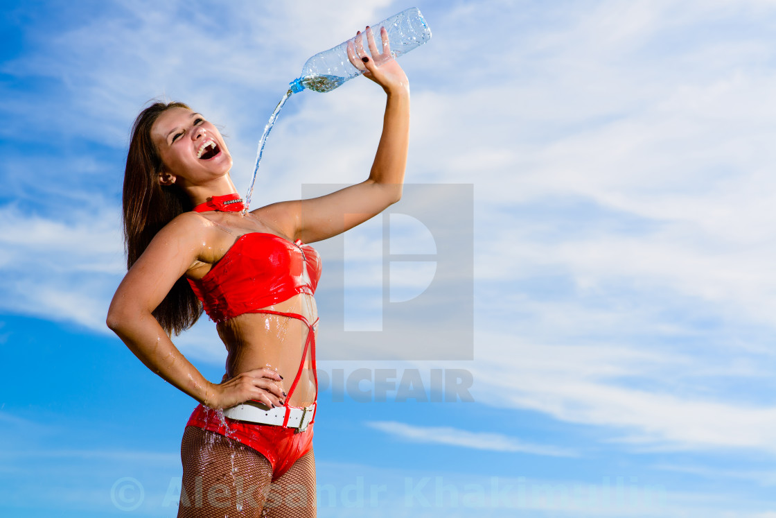 """""""sport girl in red uniform with a bottle of water"""" stock image"""