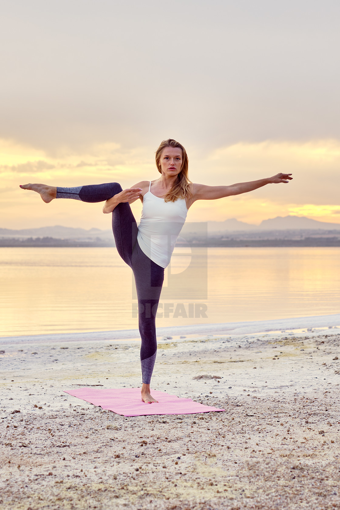Yogi woman do balancing yoga pose on nature - License, download or