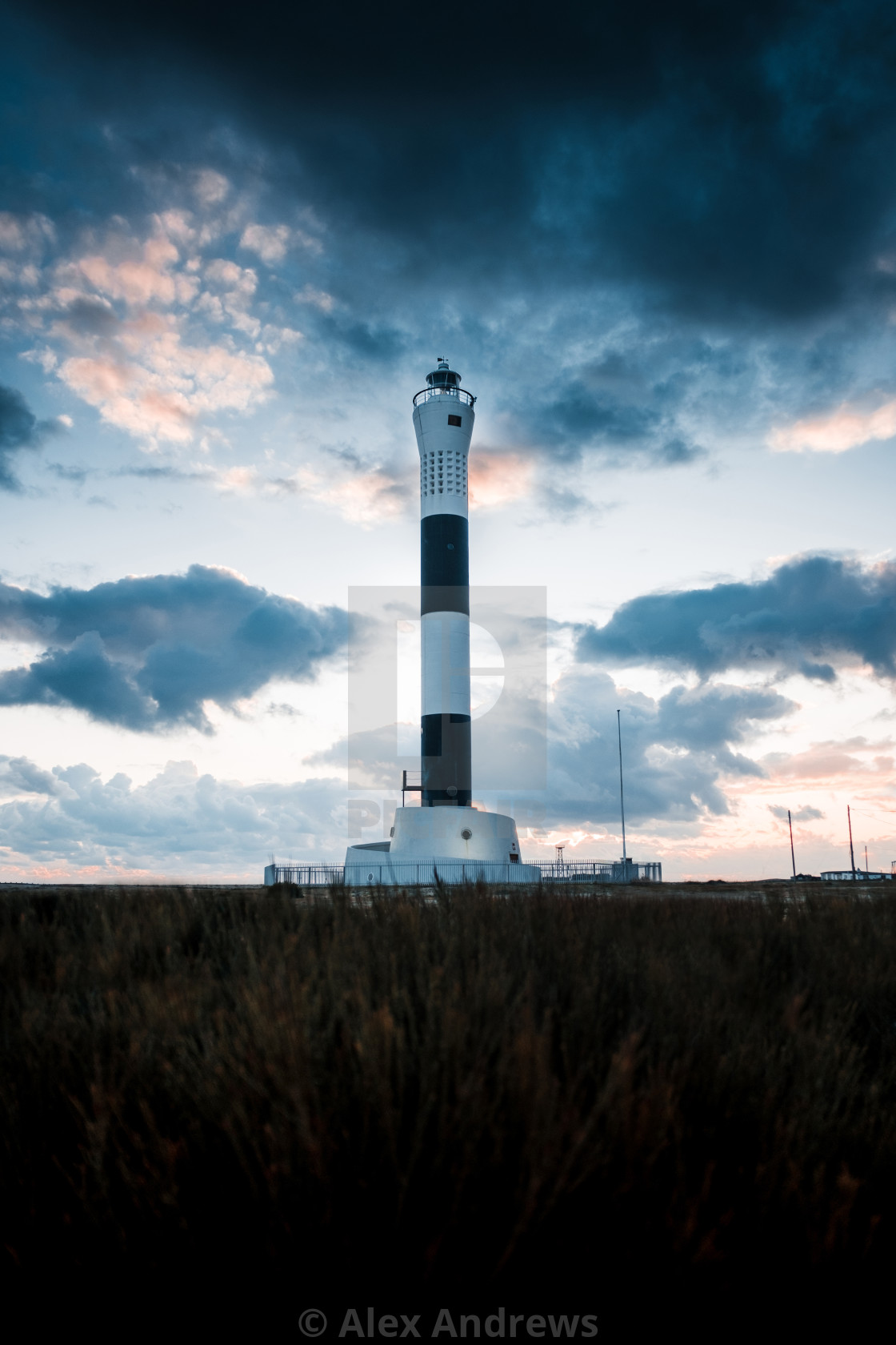 """lighthouse in the clouds"" stock image"